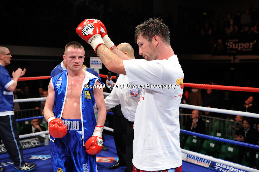 Light Welterweight Michael Lomax acknowledges defeat and congratulates his opponent Frankie Gavin at York Hall, Bethnal Green, London on the 19th February 2011. Frank Warren Promotions. Photo credit © Leigh Dawney.