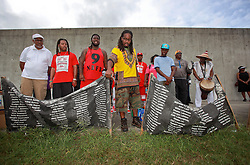 29 August 2014. Lower 9th Ward, New Orleans, Louisiana. <br /> Activists, residents and survivors hold a rally at the site where the levee breached in memory of those who perished in the storm 9 years ago.<br /> Photo; Charlie Varley/varleypix.com