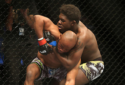 Pope Djembo (Red) attempts to break Regis Muyambo (Blue) hold during the Mixed Martial Arts Extreme Fighting Championships, EFC 52 held at the Grand West Casino in Cape Town, South Africa on the 5th August 2016<br /> <br /> Photo by:   Shaun Roy / Real Time Images