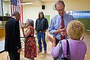 13 OCTOBER 2010 - TUCSON, AZ: Libertarian Barry Hess (CQ) LEFT and Democrat Terry Goddard (CQ) CENTER RIGHT, talk to voters after a candidate forum in Tucson. Goddard spent the day in Tucson campaigning. Goddard lost the election to sitting Governor Jan Brewer, a conservative Republican.     PHOTO BY JACK KURTZ