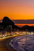 Overview of Avenida Atlantica and Copacabana Beach predawn, with Sugarloaf Mountain in background, Rio de Janeiro, Brazil.