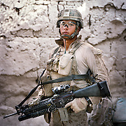 Location:<br /> Patrol Base Fires, Sangin District, Helmand Province, Afghanistan<br /> <br /> Unit: <br /> 3rd Squad, 1st Platoon, Bravo Company, 1st Battalion, 5th Marines<br /> <br /> Name and Rank: Corporal Manuel &quot;Dozer&quot; Mendoza<br /> <br /> Age: 20<br /> <br /> Hometown: Weslaco, Texas<br /> <br /> Why did you join the Marine Corps?<br /> <br /> &quot;I joined the Marine Corps because I&rsquo;ll never forget September 11th . . .  I love my country, I&rsquo;m a patriot straight up, even though I&rsquo;m Mexican. I feel like I got a debt to the United States because I have such a great life back at home. I have my family, I had a good education, you know? So I felt like I gotta pay that debt.&quot;<br /> <br /> <br /> What did you expect from Afghanistan?<br /> <br /> &quot;I did expect the whole death thing. Blood . . . I wasn't expecting the blood, bones dangling everywhere, I wasn't expecting that. I was hoping I wouldn't have to see that.&quot;<br /> <br /> Why do you think the Taliban are fighting?<br /> <br /> &quot;What I think about the Taliban, I think they're just misled. They don't know what they're fighting for, most of them. They're forced to believe in things they don't understand. They are ruthless, but only because they're forced to. They're evil men though, 'cause they don't stand up for themselves. THey don't stand up for what's right, and war is not right. Beating women and children, beating helpless civilians, that's not right.&quot;<br /> <br /> &quot;All they use is fear. They make the people fear them, and that's where they gain their power. The power is with the people, so that's why the whole counterinsurgency thing is good, it's good to do it. Because the people are the key to Afghanistan, whether we like it or not, it is what it is. The people are the key to Afghanistan, and that's what a lot of coalition forces don't really understand.&quot;<br /> <br /> &quot;They try to drill it into our heads. But once we start getting hu