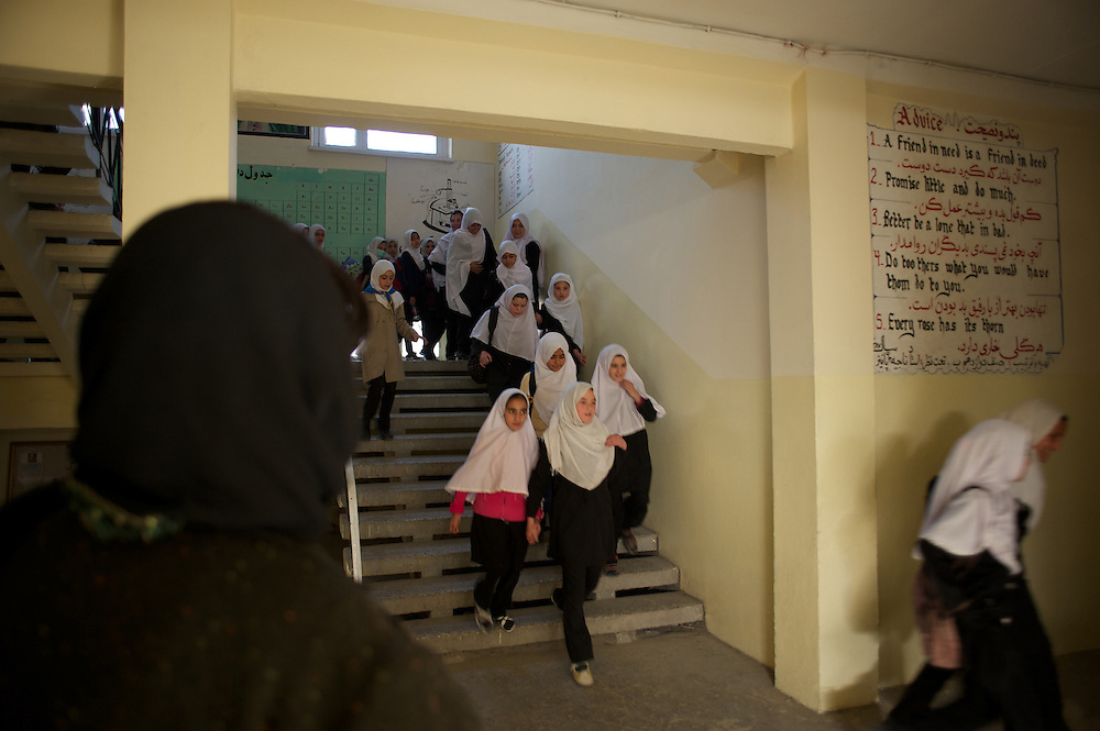 November 11, 2012 - Kabul, Afghanistan: Female students pass by leaving their last class of the day at Shirino High School in Kabul...After decades without access to education under the Taliban regime, and despite the still existent social stigmas, female students make now 40 per cent of the over all students in the country. (Paulo Nunes dos Santos)