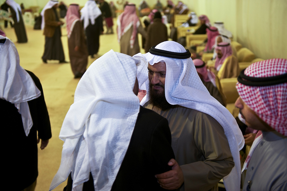 Former Kuwaiti MP Mohammed Hayef (2nd from right) is congratulated by voters and supporters on the outskirts of Kuwait City, following his election in the parliamentary elections, February 3, 2012.  Kuwaiti chose among 285 candidates for the new 50-seat assembly.