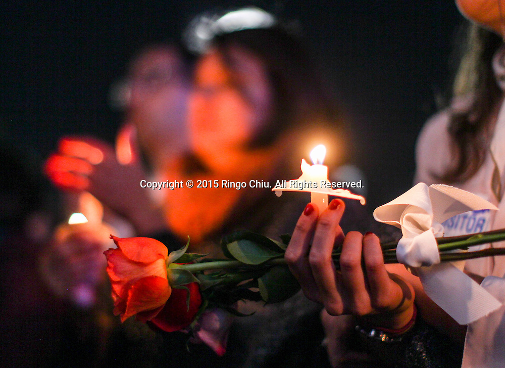People hold candle lights in a memorial service outside Los Angeles City Hall in memory of the victims of Friday's attacks in Paris on November 17, 2015 in Los Angeles.(Photo by Ringo Chiu/PHOTOFORMULA.com)<br /> Usage Notes: This content is intended for editorial use only. For other uses, additional clearances may be required.