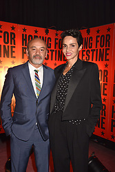 """Christian Louboutin, Farida Khelfa at """"Hoping For Palestine"""" Benefit Concert For Palestinian Refugee Children held at The Roundhouse, Chalk Farm Road, England. 04 June 2018."""