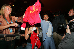 LIVERPOOL, ENGLAND - WEDNESDAY, JUNE 9th, 2005: Legend Henri Leconte celebrates winning the auction for Liverpool FC's Dietmar Hamann's shirt at the Players Party at the St Thomas Hotel during the 4th Liverbird Developments Liverpool International Tennis Tournament. (Pic by Dave Rawcliffe/Propaganda)