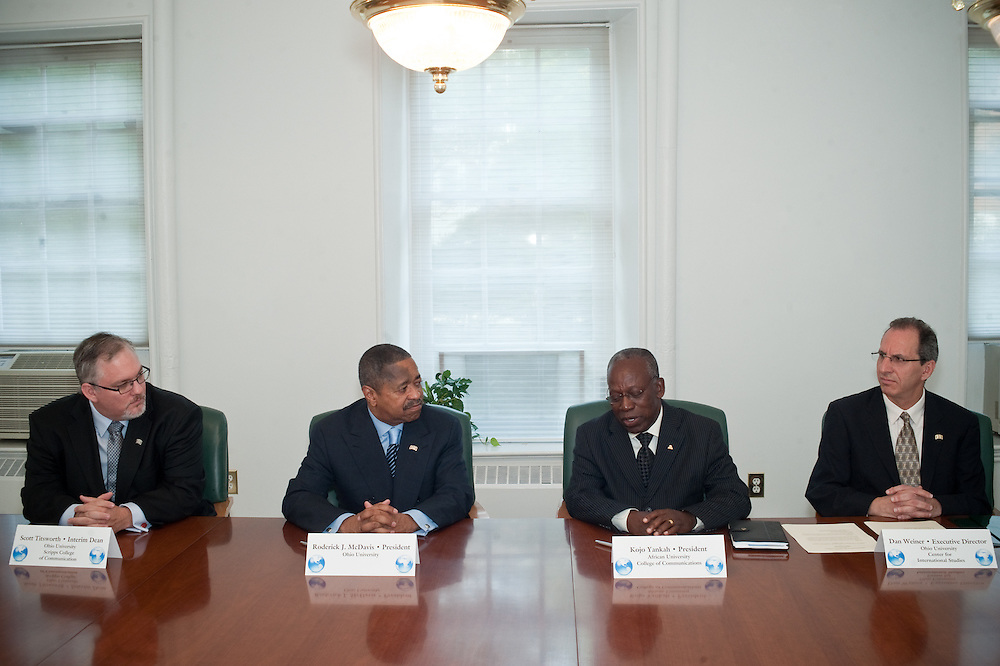 President McDavis and African University President Kojo Yankah sign international agreement.