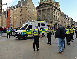 Pictured: Police allow an ambulance thru the cordon.<br /> <br /> Climate change protesters blocked roads in the city centre including North Bridge, causing severe traffic disruption.<br /> <br /> © Dave Johnston / EEm