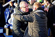 Peterborough United manager Steve Evans greets Walsall manager Dean Keates before the EFL Sky Bet League 1 match between Peterborough United and Walsall at London Road, Peterborough, England on 22 December 2018.