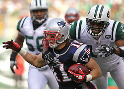 Sept 19, 2011; East Rutherford, NJ, USA; New York Jets wide receiver Brad Smith (16) tackles New England Patriots wide receiver Julian Edelman (11) during the 1st half at the New Meadowlands Stadium.