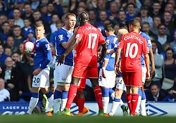 Everton's James McCarthy argues with Mamadou Sakho of Liverpool  - Mandatory byline: Matt McNulty/JMP - 07966 386802 - 04/10/2015 - FOOTBALL - Goodison Park - Liverpool, England - Everton  v Liverpool - Barclays Premier League