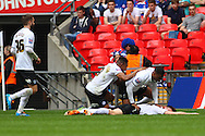 Shaun Brisley of Peterborough United (laying on floor) celebrates scoring his team's second goal to make it 2-0 during the Johnstone's Paint Trophy Final match at Wembley Stadium, London<br /> Picture by David Horn/Focus Images Ltd +44 7545 970036<br /> 30/03/2014