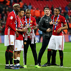 Manchester United players celebrate with the EFL Trophy - Mandatory by-line: Matt McNulty/JMP - 26/02/2017 - FOOTBALL - Wembley Stadium - London, England - Manchester United v Southampton - EFL Cup Final