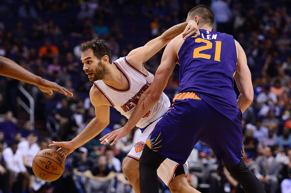 Mar 9, 2016; Phoenix, AZ, USA; New York Knicks guard Jose Calderon (3) handles the ball against Phoenix Suns center Alex Len (21) in the second half at Talking Stick Resort Arena. The New York Knicks defeated the Phoenix Suns 128-97. Mandatory Credit: Jennifer Stewart-USA TODAY Sports