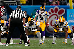Joe Burrow #9 of the LSU Tigers makes a call at the line of scrimmage during the first half against the Oklahoma Sooners in the 2019 College Football Playoff Semifinal at the Chick-fil-A Peach Bowl on Saturday, Dec. 28, in Atlanta. (Paul Abell via Abell Images for the Chick-fil-A Peach Bowl)