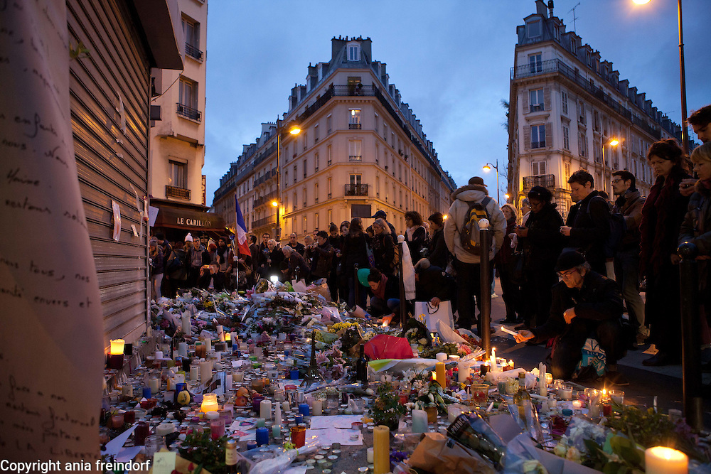 "Paris Terrorist Attacks, people Mourning in front of Bar ""Le Carillon"" and Restaurant ""Le Petit Cambodge"", where 15 people died from Kalashnikov shooting on 13/11/15."