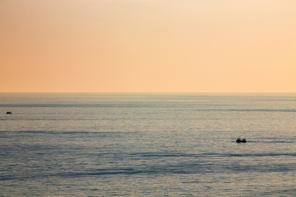 Two fishing trawler boats sailing and fishing in the calm waters of The English Channel at sunset photographed from Folkestone, Kent, England, United Kingdom. (photo by Andrew Aitchison / In pictures via Getty Images)