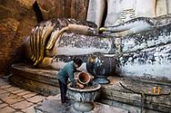 Buddhist faith in Wat Si Chum Buddha gigantic statue