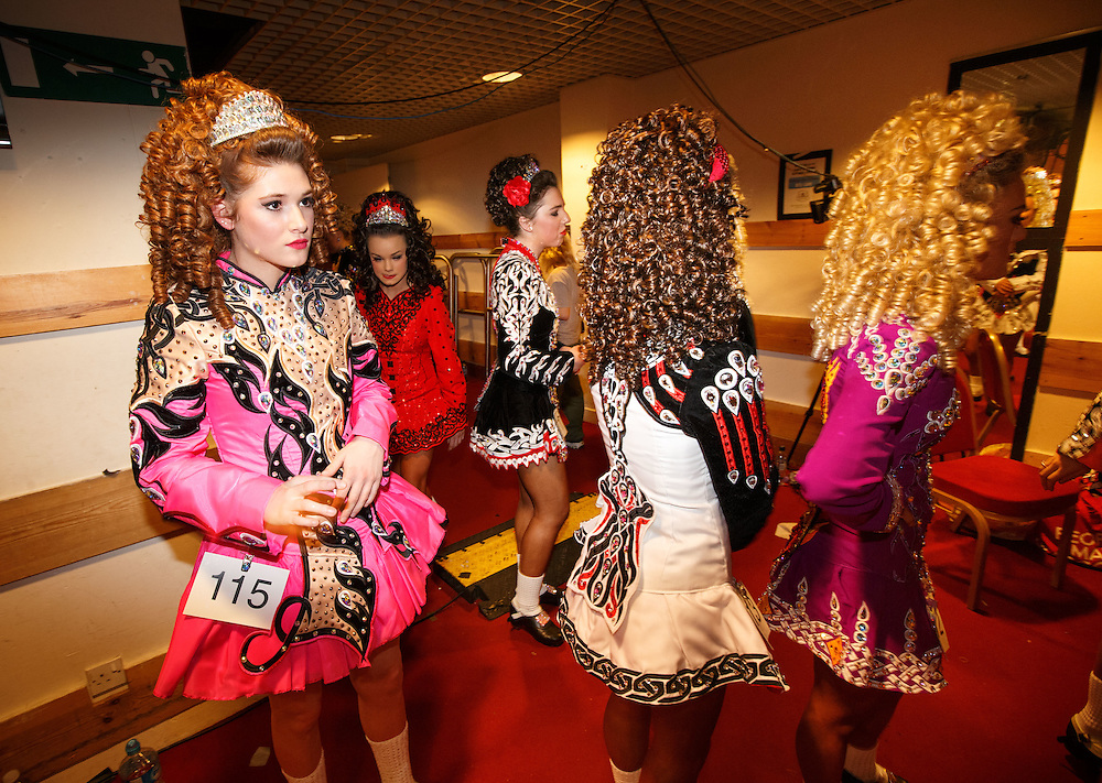 "Belgian Irish Dancer Alicia Bellemans, left(16) prepares to enter the stage. She got to Glasgow for The 46th annual World Irish Dancing Championships at the Glasgow Royal Concert Hall from March 20th- 27th 2016. From Brussels she is the first Belgian to have qualified for the Championships and were not letting the terrorist  attack and airport closures and transport problems beat them to fulfil their passion to compete at Irish Dancing. Alicia said "" We have to do what we love. We won't stop, they won't stop our passion for Irish dancing, we are afraid, but we fight"". Alicia had to be in Glasgow for her dance slot at 12.30. She has been on the move since 2am and finally got here via Amsterdam.  Picture Robert Perry 23rd March 2016<br /> <br /> Must credit photo to Robert Perry<br /> FEE PAYABLE FOR REPRO USE<br /> FEE PAYABLE FOR ALL INTERNET USE<br /> www.robertperry.co.uk<br /> NB -This image is not to be distributed without the prior consent of the copyright holder.<br /> in using this image you agree to abide by terms and conditions as stated in this caption.<br /> All monies payable to Robert Perry<br /> <br /> (PLEASE DO NOT REMOVE THIS CAPTION)<br /> This image is intended for Editorial use (e.g. news). Any commercial or promotional use requires additional clearance. <br /> Copyright 2014 All rights protected.<br /> first use only<br /> contact details<br /> Robert Perry     <br /> 07702 631 477<br /> robertperryphotos@gmail.com<br /> no internet usage without prior consent.         <br /> Robert Perry reserves the right to pursue unauthorised use of this image . If you violate my intellectual property you may be liable for  damages, loss of income, and profits you derive from the use of this image."