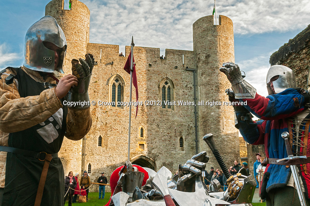 Knights putting on gloves<br /> Medieval Christmas Fayre<br /> Caerphilly Castle<br /> December 2011<br /> South<br /> Historic Sites<br /> Events