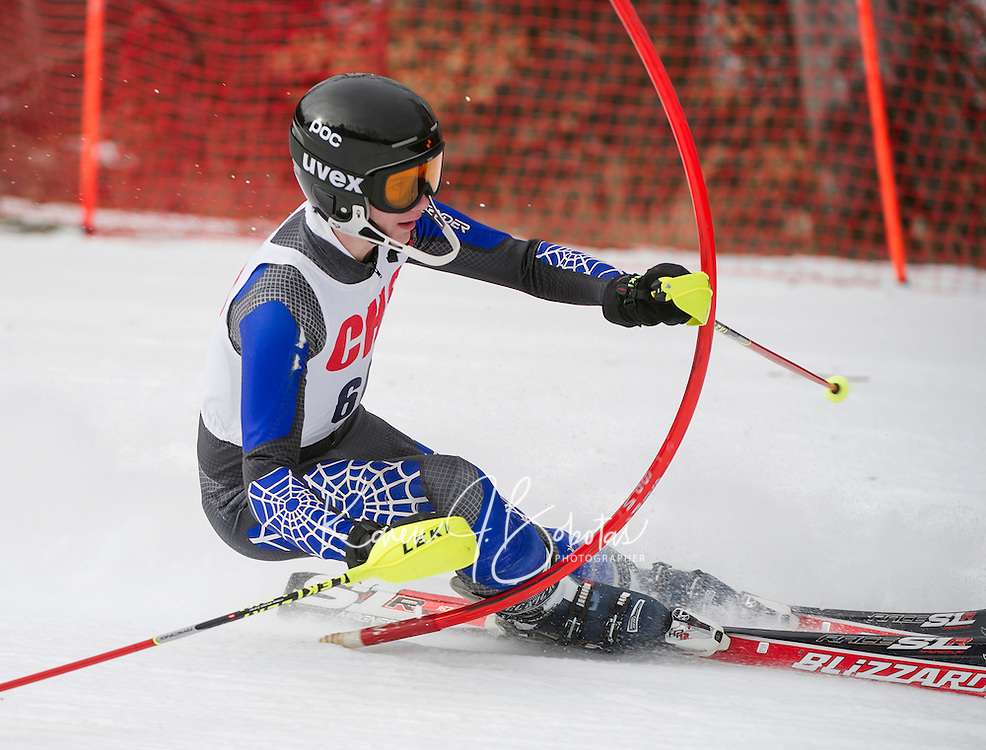Concord High School's Liam Healy crushes the slalom gate during Saturday's Capital Cup at Blackwater/Proctor Ski Area.  (Karen Bobotas/for the Concord Monitor)