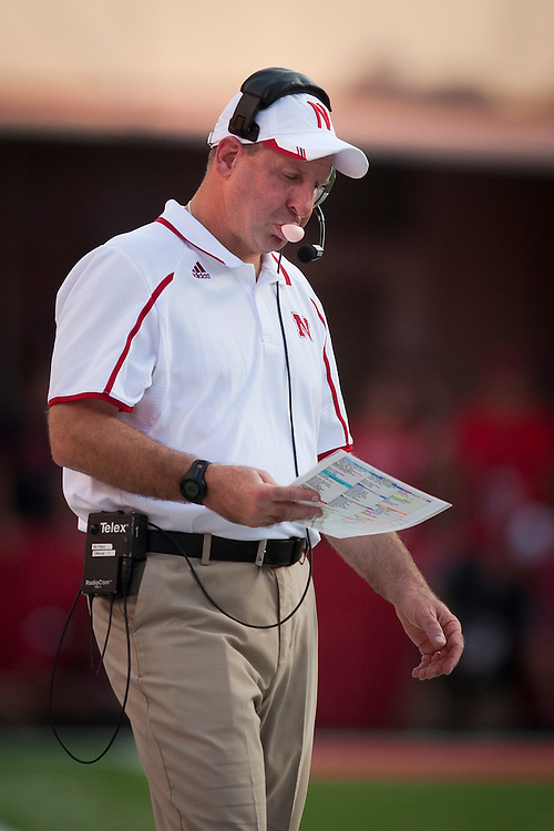 Nebraska Cornhuskers head coach Bo Pelini blows a bubble during their Saturday Sept 7, 2013 NCAA football game in Lincoln, Neb.(Photo by/John S Peterson)