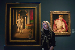 "© Licensed to London News Pictures. 28/02/2019. LONDON, UK. A staff member views (L to R) ""Lover in an Interior"" before 1497 by Jacometto Veneziano or close follower and ""Saint Sebastian"" c1533 by Agnolo Bronzino. Preview of ""The Renaissance Nude"", an exhibition at the Royal Academy of Arts in Piccadilly of 90 works examining the emergence of the nude in European art.  Works by artists including Leonardo da Vinci to Michelangelo are on display in the Sackler Galleries 3 March to 2 June 2019.  Photo credit: Stephen Chung/LNP"