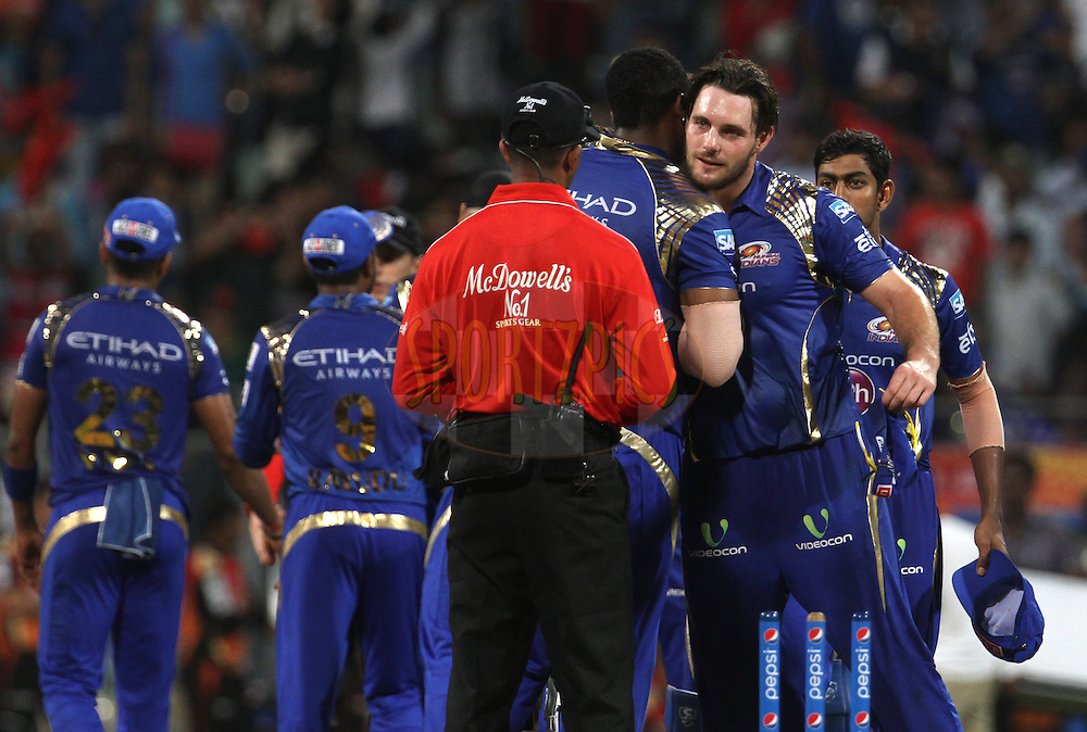 Mumbai Indians players shake hands after winning the match 23 of the Pepsi IPL 2015 (Indian Premier League) between The Mumbai Indians and The Sunrisers Hyderabad held at the Wankhede Stadium in Mumbai India on the 25th April 2015.<br /> <br /> Photo by:  Vipin Pawar / SPORTZPICS / IPL