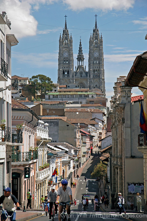 South America, Ecuador, Quito.  Street of the old city of Quito and the Basilica del Voto Nacional.