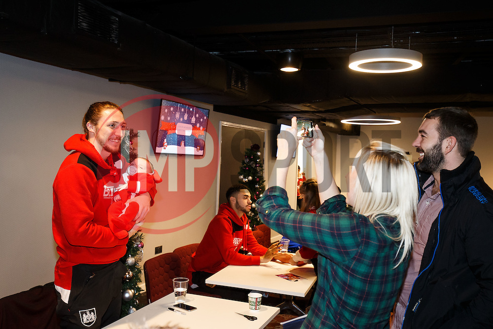 Luke Ayling of Bristol City poses with young fans as Season ticket holders and members of Bristol Sport 7s and Forever Bristol take part in a Bristol Sport Christmas Party - Mandatory byline: Rogan Thomson/JMP - 22/12/2015 - SPORT - Ashton Gate Stadium - Bristol, England - Bristol Sport Christmas at Ashton Gate.