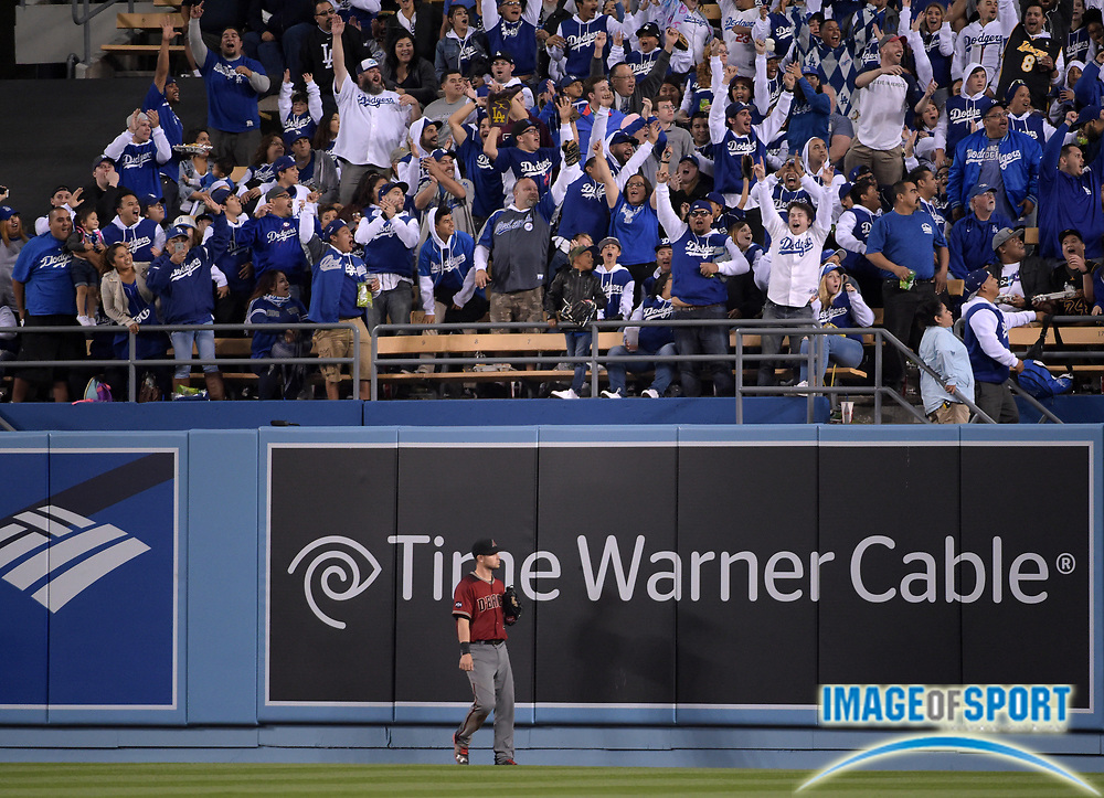 Apr 13, 2016; Los Angeles, CA, USA; Arizona Diamondbacks center fielder Chris Owings (16) reacts after a solo home run by Los Angeles Dodgers first baseman Adrian Gonzalez (not pictured) in the fourth inning during a MLB game at Dodger Stadium.