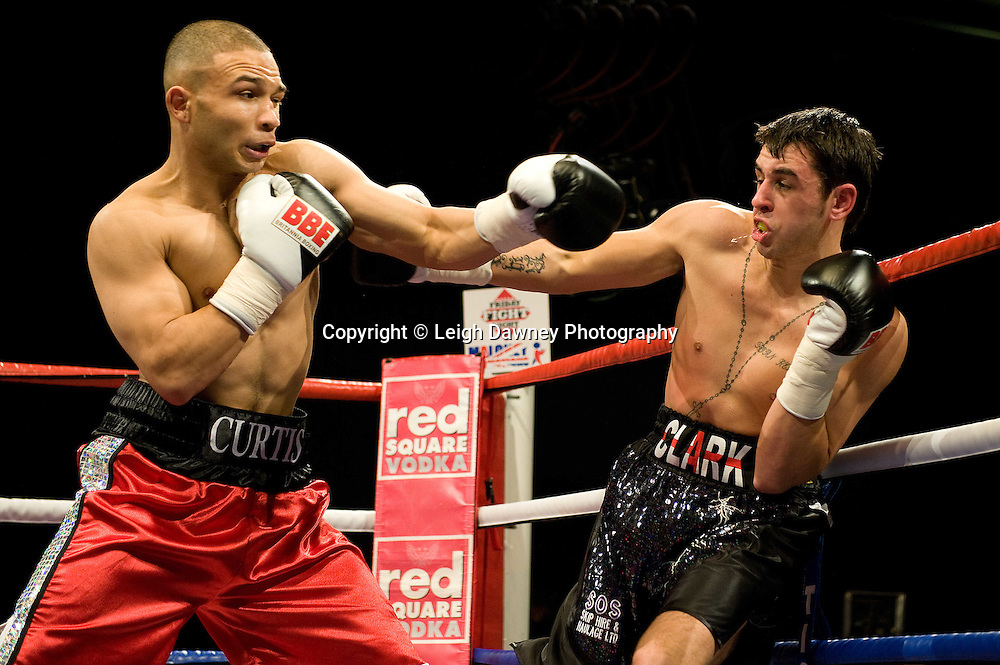 Curtis Valentine (red shorts) defeats Ryan Clark at the Harvey Hadden Leisure Centre 5th February 2010 Frank Maloney Promotion. Photo credit © Leigh Dawney