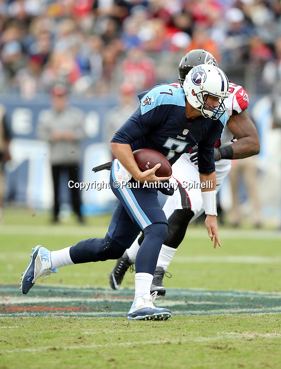 Tennessee Titans quarterback Zach Mettenberger (7) runs the ball as he gets flushed out of the pocket during the 2015 week 7 regular season NFL football game against the Atlanta Falcons on Sunday, Oct. 25, 2015 in Nashville, Tenn. The Falcons won the game 10-7. (©Paul Anthony Spinelli)
