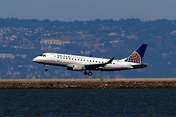 Embraer ERJ-175LR (N153SY) operated by SkyWest Airlines for United Express landing at San Francisco International Airport (KSFO), San Francisco, California, United States of America