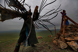 Mongolian Shaman Gankhuyag Batmunkh dances in a trance during a  Shaman ceremony by an 'ovoo' or 'sacred stone' site on Black Mountain Head in Nalaikh district of Ulan Bator in Mongolia, 06 July 2012. The Shaman ceremony is held for a family to give offerings to the spirits of nature and to bring good karma to the members of family. Shamanism comes from the term 'shamans' that refers to priests or mediums that acts as vessels for spirits, gods and demons to communicate with the human world. In Mongolia, they adhere to the ancient beliefs of Tengrism, where spirits live in all of nature, in the sun, moon, lakes, rivers, mountains, and trees.