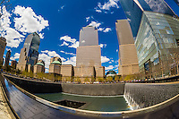National September 11 Memorial & Museum with One World Trade Center and World Financial Center in background, New York, New York USA.