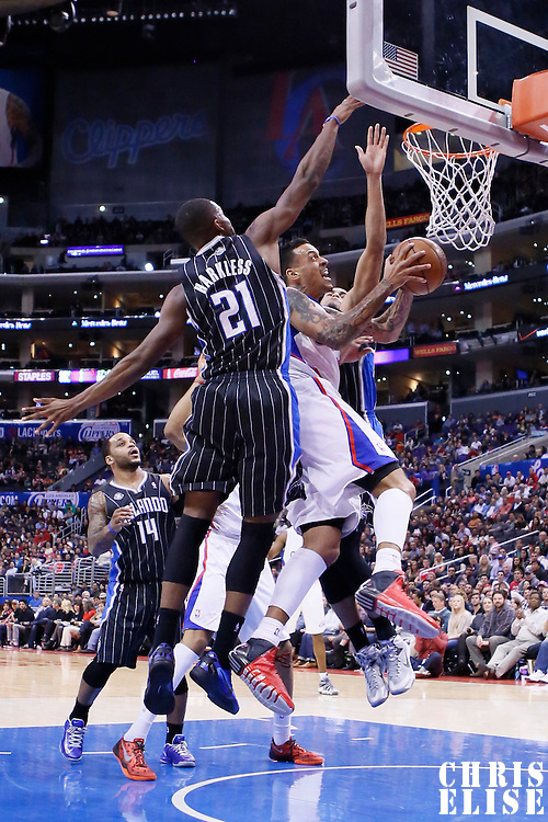 06 January 2014: Los Angeles Clippers small forward Matt Barnes (22) goes for the layup past Orlando Magic small forward Maurice Harkless (21) during the Los Angeles Clippers 101-81 victory over the Orlando Magic at the Staples Center, Los Angeles, California, USA.