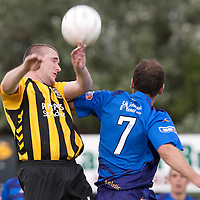 East Fife v Forfar...25.07.09...Alba Challenge Cup<br /> Scott Thomson wins the header against Martyn Fotheringham<br /> Picture by Graeme Hart.<br /> Copyright Perthshire Picture Agency<br /> Tel: 01738 623350  Mobile: 07990 594431