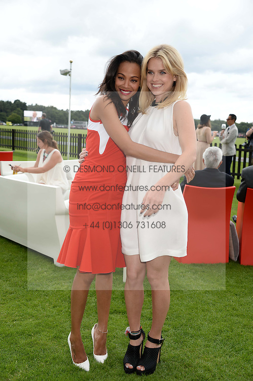 Left to right, ZOE SALDANA and ALICE EVEat the Audi International Polo at Guards Polo Windsor Great Park, Egham, Surrey on 28th July 2013.