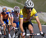 France - Tuesday, Jul 22 2008: CSC-Saxo Bank's Fränk Schleck (Lux) wearing the race leader's yellow jersey on the climb of the Col de Restefond during Stage 16 of the 2008 Tour de France cycle race. (Photo by Peter Horrell / http://www.peterhorrell.com)