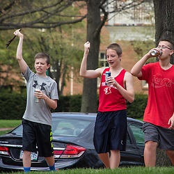 Three young boys singing while walking down High Street Saturday April 26, 2014. (Christina Paolucci, photographer).