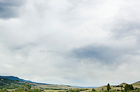 Rolling hills in Southwestern Montana, under a big cloudy sky.  USA.