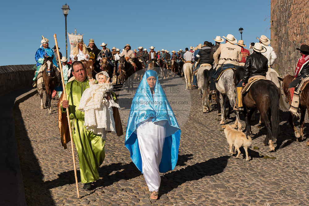 A costumed Mary and Joseph lead a procession from the Cristo Rey shrine on top Cubilete Mountain at the end of the annual Cabalgata de Cristo Rey pilgrimage January 6, 2017 in Guanajuato, Mexico. Thousands of Mexican cowboys take part in the three-day ride to the mountaintop shrine of Cristo Rey which concludes on the Day of Epiphany.
