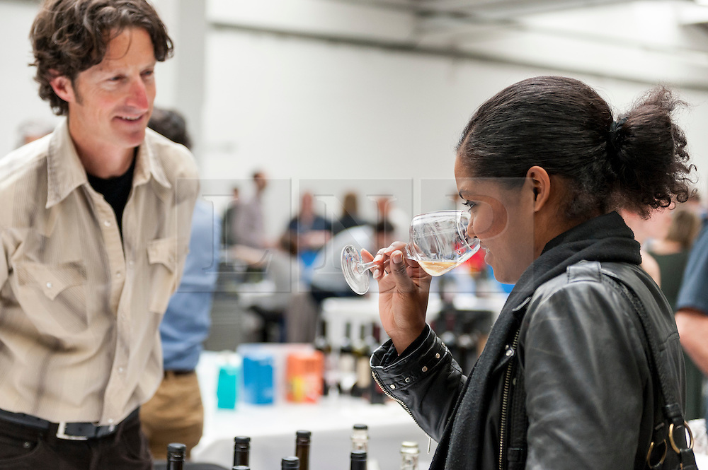 © Licensed to London News Pictures. 16/05/2016. London, UK. A visitor samples wine. Buyers and wine lovers visit the Raw Wine Fair at the Old Truman Brewery near Brick Lane.  The fair brings over 180 artisan growers and wine makers from around the world who specialise in producing organic, biodynamic and naturally made wines with minimal additives. Photo credit : Stephen Chung/LNP