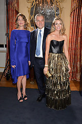 Left to right, MARIA-CRISTINA BUCCELLATI, ANDREA BUCCELLATI and LUCREZIA BUCCELLATI at an evenig of Jewellery & Photography to launch the Buccellati 'Opera Collection' held at Spencer House, London on 21st October 2015.