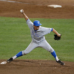 Jun 24, 2013; Omaha, NE, USA; UCLA Bruins pitcher David Berg (26) delivers a pitch during the ninth inning in game 1 of the College World Series finals against the Mississippi State Bulldogs at TD Ameritrade Park. UCLA defeated Mississippi State 3-1. Mandatory Credit: Derick E. Hingle-USA TODAY Sports