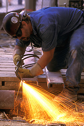 Stock photo of a workman cutting steel during new construction at George R. Brown Convention Center in Houston, Texas