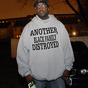 Date: 12/1/06<br /> desk: metro<br /> slug: dorismond<br /> id: 30034277A<br /> <br /> Mourner Robert Jones stands outside of the wake/funeral of Sean Bell, 23, whose murder is referenced on the sweatshirt he had made and who comes from his neighborhood in Queens, at the Community Church of Christ in Queens, New York on December 1, 2006. Bell was killed in a hail of 50 bullets by New York City police officers in the early morning of November 25, 2006 leaving his bachelor party at Club Kalua in Queens, just hours before he as scheduled to marry in the church where his funeral was held.<br /> <br /> &quot;This is the voice of countless African-American men, women and children,&quot; said Jones. &quot;We're being harassed by the people who are supposed to be protecting us. No one has good police relations in this community.&quot; <br /> <br /> photo by Angela Jimenez for The New York Times<br /> photographer contact 917-586-0916