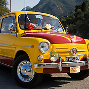 1961 Fiat 750 with Castellammare del Golfo in background, Sicily, Italy